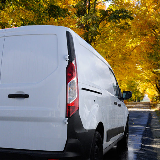 Van driving through picturesque road to promote fleet insurance by Evalee Insurance Brokers