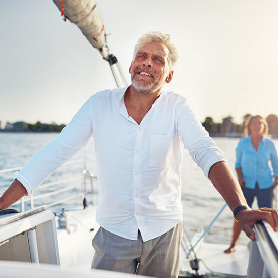 Yacht owner staring wistfully into the ocean to promote high net worth insurance by Evalee Insurance Brokers