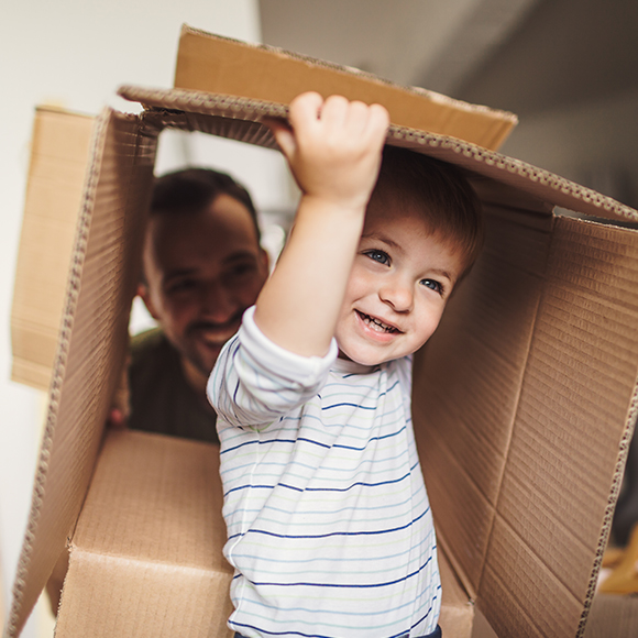 Young boy playing inside a cardboard box to promote home insurance by Evalee Insurance Brokers
