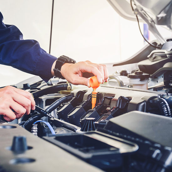 Mechanic working on car to promote motor trade insurance by Evalee Insurance Brokers