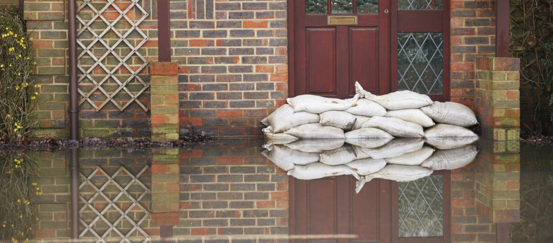 Sandbags used as a flood defence outside family home to promote flooding insurance by Evalee Insurance Brokers